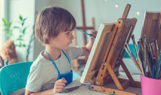 Child painting on canvas
