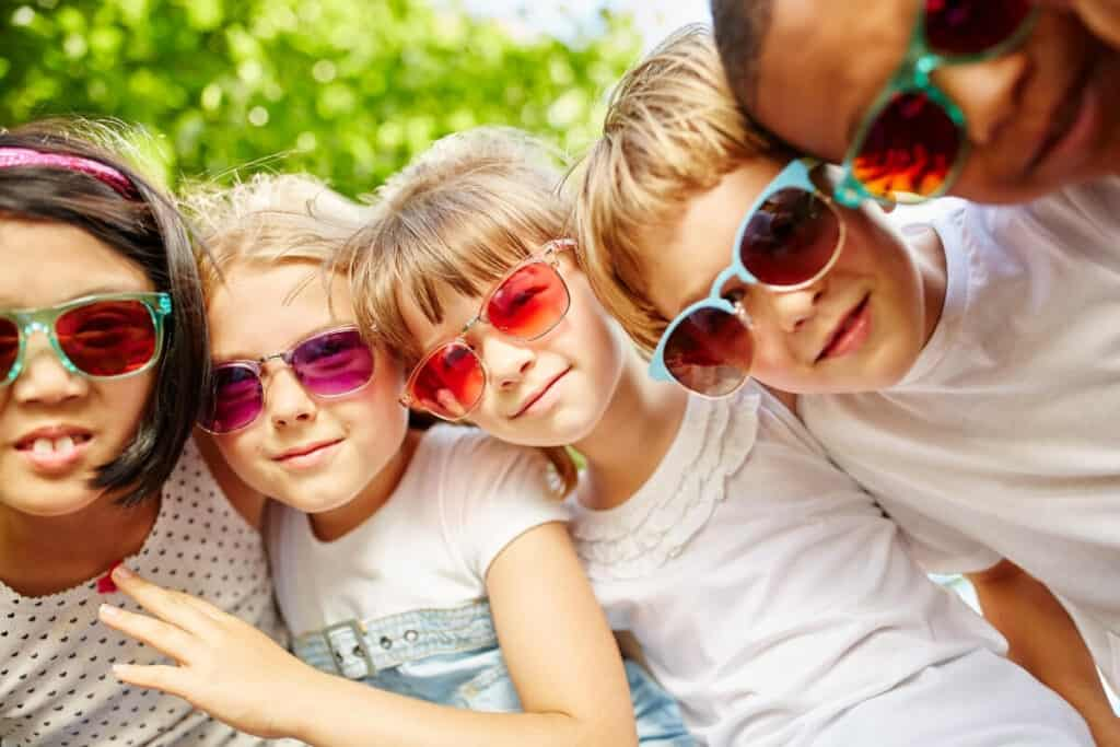 Eye protection children wearing sunglasses