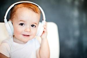 toddler in headphones audiobook